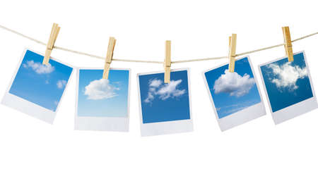 polaroids: prints with clouds pictures isolated on white Stock Photo