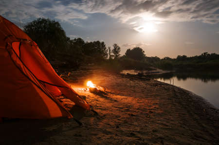 camping at night with campfire photo