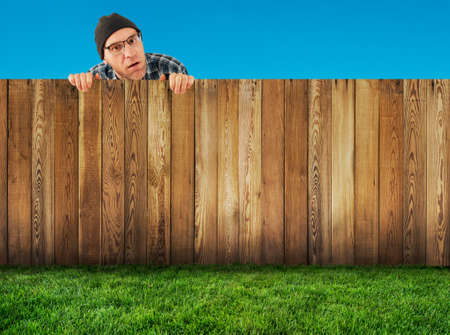 Man  behind the fence  photo
