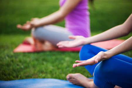 yoga outside: couple doing yoga outdoors