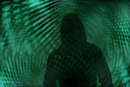 computer crime: Silhouette of a hacker with binary codes Stock Photo