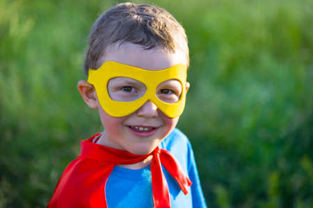 dressing up costume: child acting like a super hero