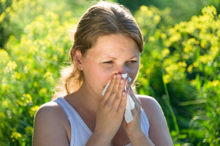 woman suffering from pollen allergy Stock Photo