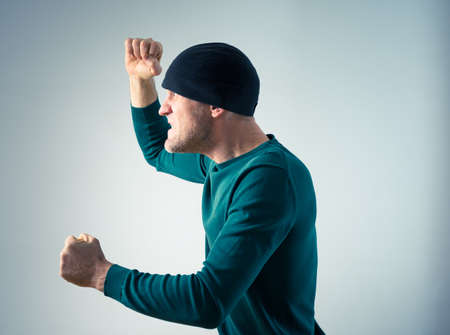 boiling point: angry man acting mad Stock Photo