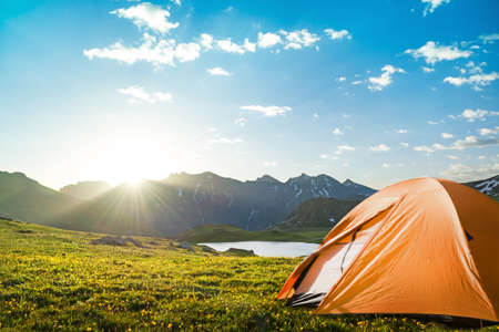 tourist tent camping in mountains photo