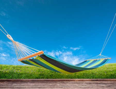 Relaxing on hammock in backyard Stock Photo