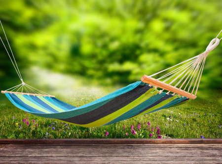 Relaxing on hammock in garden Foto de archivo