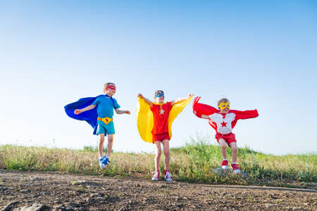 dressing up costume: children acting like a superhero Stock Photo