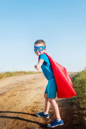 dressing up costume: child acting like a super hero  Stock Photo