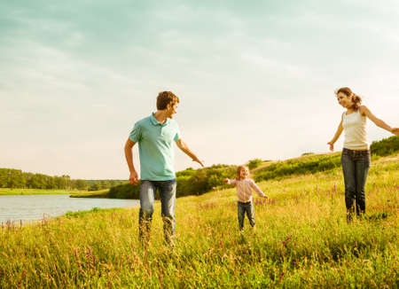 happy family having fun outdoors Banco de Imagens