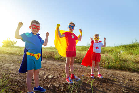 children acting: children acting like a superhero Stock Photo