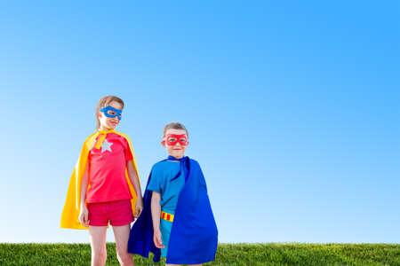 dressing up costume: kids acting like a superhero