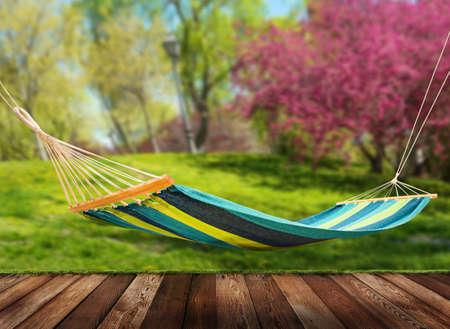in hammock: Relaxing on hammock in garden Stock Photo