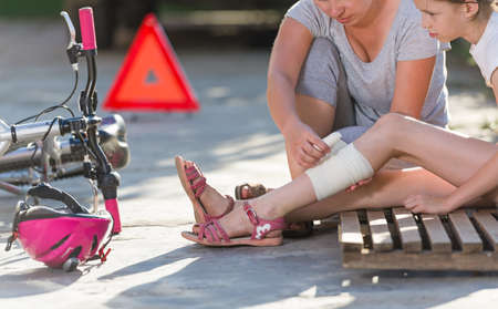bicycle girl: child after bicycle accident Stock Photo