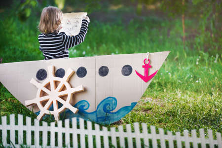 pirate girl: kid plays pirate at backyard