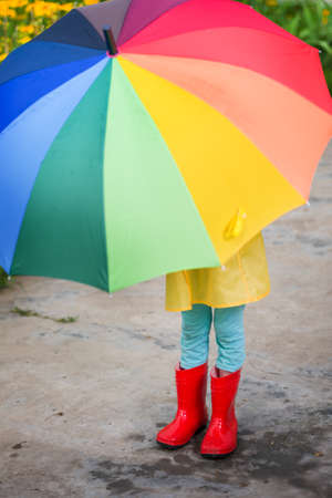 child with umbrella and boots Stock Photo
