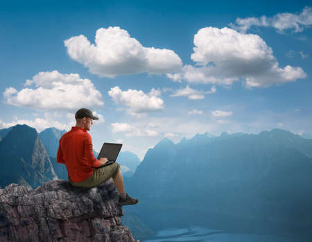 man working outdoors with laptop Stock Photo
