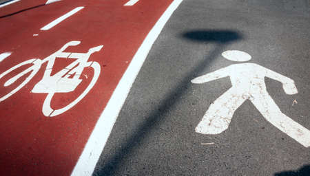 pedestrian: pedestrian and bicycle signs on road Stock Photo