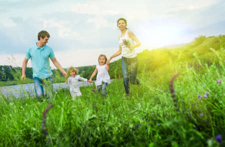 outdoors woman: happy family having fun outdoors Stock Photo