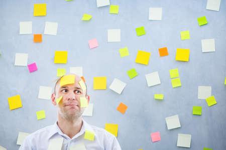 sticky: businessman overwhelmed with sticky reminder notes Stock Photo