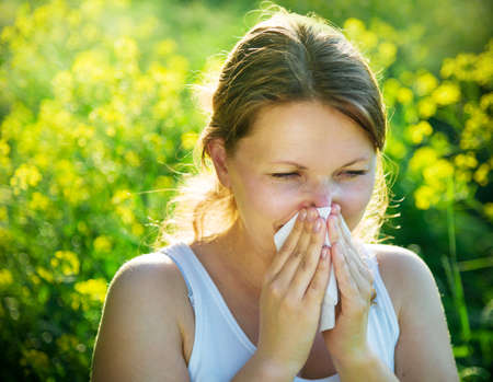 with pollen: woman suffering from pollen allergy Stock Photo