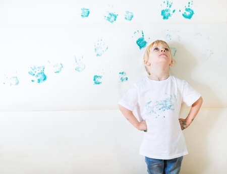 children at play: messy kid painting