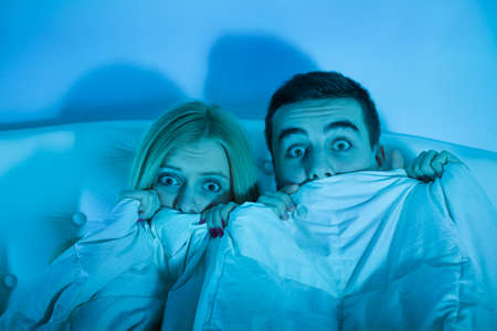 horror movie: frightened couple watching a horror movie