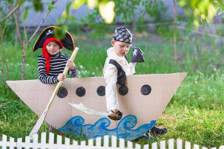 children at play: children play pirates at backyard