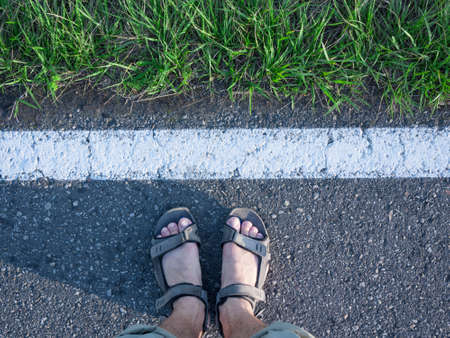 pilgrim journey: feet at road Stock Photo