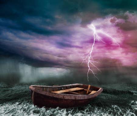 dark skies: old boat in the stormy ocean