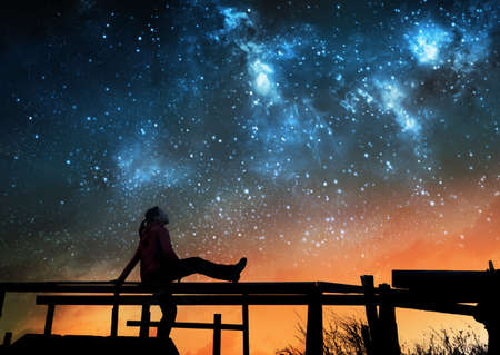 Girl watching the stars in night sky