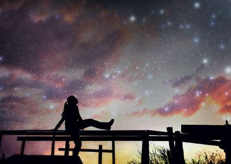 stars night: Girl watching the stars in night sky
