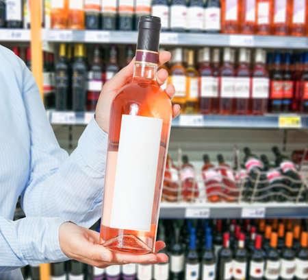shopper: wine shopping choosing concept