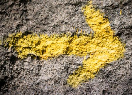 camino: yellow arrow at Camino de Santiago Stock Photo