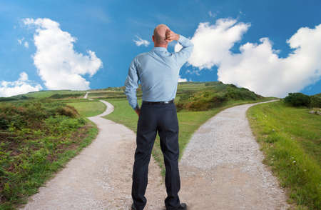man at fork in the road concept image Stock Photo