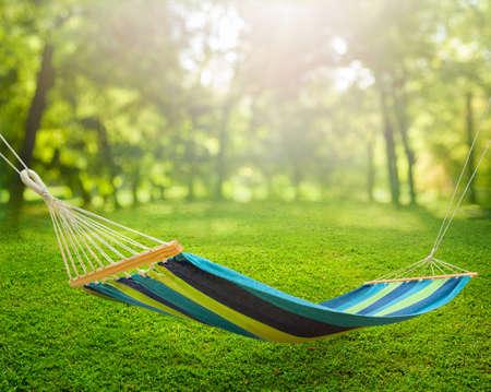 Relaxing on hammock in garden 免版税图像