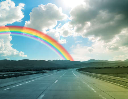 Storm weather and rainbow on road, travel concept
