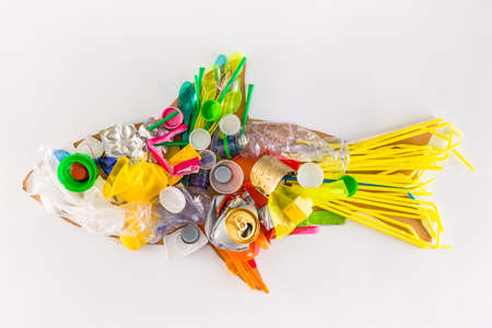 plastic fish made of disposable and waste plastics, ecology concept Banco de Imagens