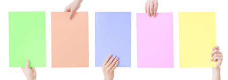 hands holding blank colorful paper isolated Banco de Imagens