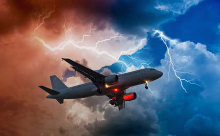 airplane flies in bad weather and storm with lightning bolt