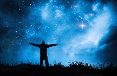 alone man watching the stars in night sky near the sea Stock fotó - 129238148