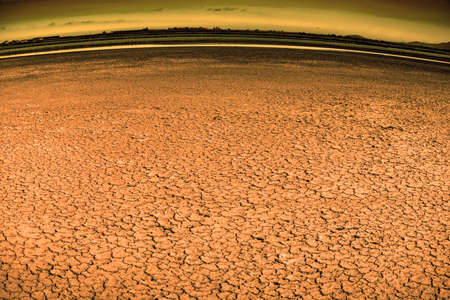 cracked soil in desert, drought and heatwave concept