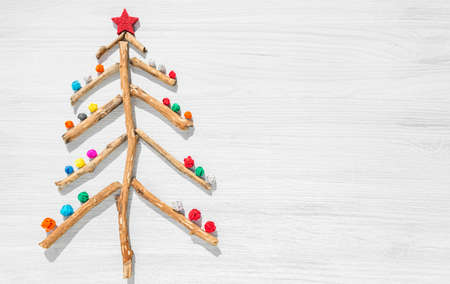 scrap DIY christmas tree on wooden background