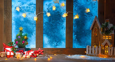 christmas cozy interior background with window sill illuminated with lights Stock Photo