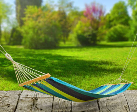 Relaxing on hammock at backyard on lawn