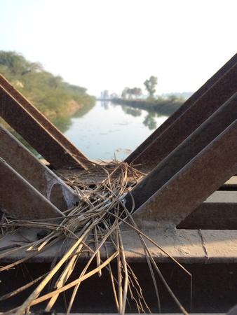 iron: A iron over bridge river scene