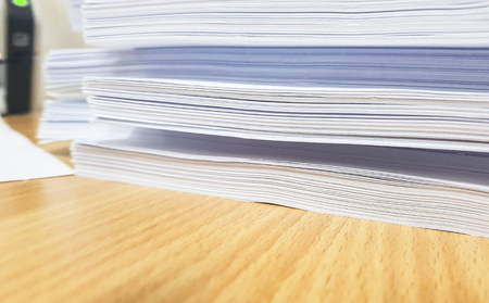 Stacks of white paper document on brown table,design for Illustration banner and website. Stock Photo
