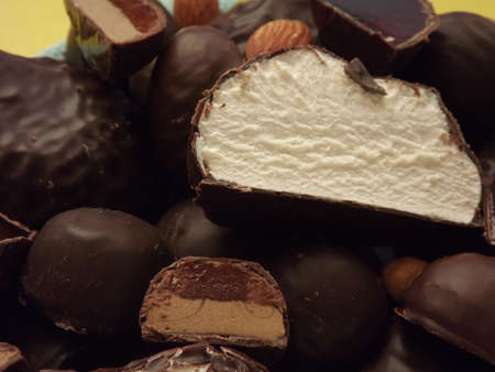 chocolate candies, marshmallows, marmalade and various nuts close-up. High quality photo Standard-Bild