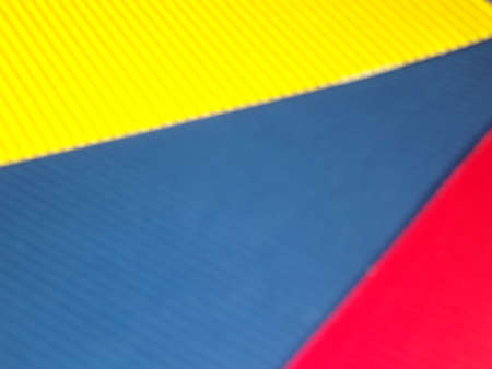 yellow blue RED ribbed corrugated background with diagonal STRIPE. High quality photo