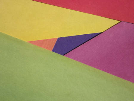 yellow, green, red, burgundy, blue, orange geometric shapes as background. High quality photo